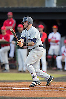 Nick Coble (34) of the Catawba Indians follows through on his swing against the against the Belmont Abbey Crusaders at Abbey Yard on February 7, 2017 in Belmont, North Carolina.  The Crusaders defeated the Indians 12-9.  (Brian Westerholt/Four Seam Images)