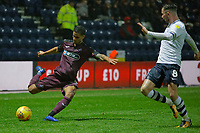 (L-R) Kyle Naughton of Swansea City crosses the ball past Alan Browne of Preston North End during the Sky Bet Championship match between Preston North End and Swansea City at Deepdale, Preston, England, UK. Saturday 12 January 2019