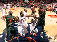 CHARLOTTESVILLE, VA- JANUARY 7: Durand Scott #1 of the Miami Hurricanes reaches for the rebound next to Virginia Cavalier defenders during the game on January 7, 2012 at the John Paul Jones Arena in Charlottesville, Virginia. Virginia defeated Miami 52-51. (Photo by Andrew Shurtleff/Getty Images) *** Local Caption *** Durand Scott