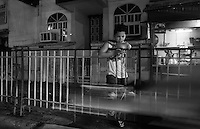 A boy and his cellphone, Street-Photography life on the streets, Manila, Philippines
