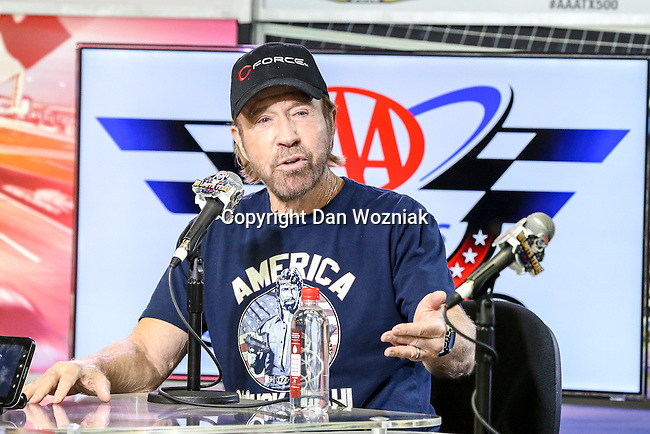 Celebrity Chuck Norris conducts an interview before the NASCAR AAA Texas 500 race at Texas Motor Speedway in Fort Worth,Texas.