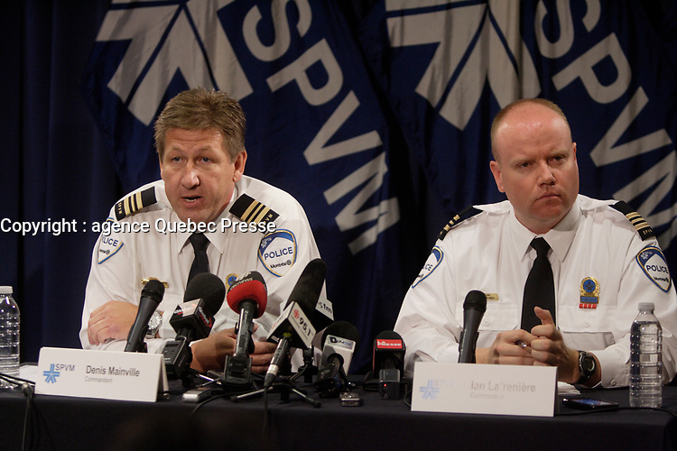 Le Commandant Denis Mainville  (G) et Ian Lafresniere , du SPVM, en 2012<br /> <br /> Lafresniere a ete elu depute de la CAQ en 2018<br /> <br /> PHOTO D'ARCHIVE: Agence Quebec Presse