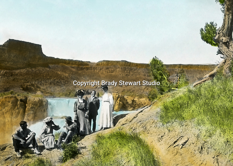 Twin Falls ID:  Idaho Homesteaders and their visitors from Pittsburgh visiting the sights.   Brady Stewart and three friends went to Idaho on a lark from 1909 thru early 1912.  As part of the Mondell Homestead Act, they received a grant of 160 acres north of the Snake River.  Brady Stewart photographed the adventures of farming along with the spectacular landscapes. To give family and friends a better feel for the adventure, he hand-color black and white negatives into full-color 3x4 lantern slides.  The Process:  He contacted a negative with another negative to create a positive slide.  He then selected a fine brush and colors and meticulously created full-color slides.
