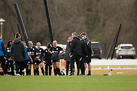 LOUISVILLE, KY - MARCH 13: Christy Holly head coach of Racing Louisville FC talks to players during half time during a game between West Virginia University and Racing Louisville FC at Thurman Hutchins Park on March 13, 2021 in Louisville, Kentucky.