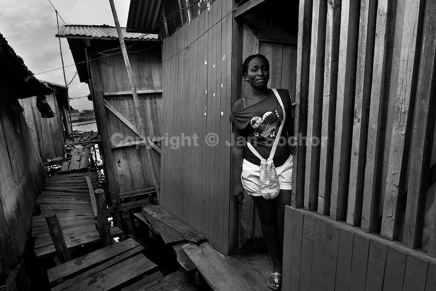 A displaced woman lives in a wooden house in the stilt house area in Tumaco, Nariño dept., Colombia, 11 June 2010. With nearly fifty years of armed conflict, Colombia has the highest number of civil war refugees in the world. During the last ten years of the civil war more than 3 million people have been forced to abandon their lands and to leave their homes due to the violence. Internally displaced people (IDPs) come from remote rural areas, where most of the clashes between leftist guerrillas FARC-ELN, right-wing paramilitary groups and government forces takes place. Displaced persons flee in a hurry, carrying just personal belongings, and thus they inevitably end up in large slums of the big cities, with no hope for the future.
