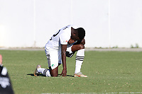 RICHMOND, VA - SEPTEMBER 30: Akeem Ward #30 of North Carolina FC takes a knee during the play of the national anthem before a game between North Carolina FC and New York Red Bulls II at City Stadium on September 30, 2020 in Richmond, Virginia.
