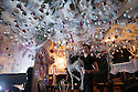 """30/11/15<br /> <br /> Barman, Brandon Christie, 20, looks for a place on the wall to put a reindeer. <br /> <br /> It has taken a team of five, two weeks to put up this stunning display of Christmas decorations in what is believed to be one of Britain's most festive pubs. The race was on to put up the 7,500 baubles and 27,000 fairy lights, before guests arrived for the pub's first Christmas parties held last night. <br /> <br /> Each of the five rooms at the Hanging Gate at Chapel-en-le-Frith in the Derbyshire Peak District has a different theme or colour. This year the main restaurant is the Indoor Igloo, the bar area is purple and gold and there's the Candy Cain room upstairs in the pub near Buxton. There's also has another 10,000 lights on the outside of the building. <br /> <br /> """"We've had to replace a few thousand of the LED lights this year, I buy them in huge lengths so it's cost lots  to get everything ready"""" said landlord Mark Thomas.<br /> <br /> All Rights Reserved: F Stop Press Ltd. +44(0)1335 418365   www.fstoppress.com."""
