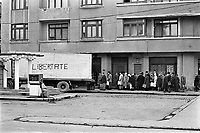"ROMANIA, Str. Maria Rosetti, Bucharest, 25.12.1989<br /> People rise against Ceausescu. The dictator has fled the city on dec. 22. Fights have been going on. Food delivery to the citizens, the lorry is marked with ""freedom"".<br /> © Andrei Pandele / EST&OST"