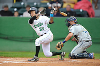 Catcher Christian Carmichael #33 of the Clinton LumberKings swings against the West Michigan Whitecaps at Ashford University Field on July  25, 2014 in Clinton, Iowa. The Whitecaps won 9-0.   (Dennis Hubbard/Four Seam Images)