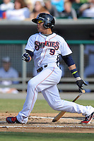 Tennessee Smokies shortstop Javier Baez #9 swings at a pitch during a game against the Mobile BayBears at Smokies Park on August 25, 2013 in Kodak, Tennessee. The BayBears won the game 2-0. (Tony Farlow/Four Seam Images)