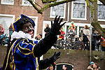 Black Petes, the helpers of Sinterklass ride a boat through the canals of Utrecht to welcome Sinterklass to the dutch city, the Netherlands.