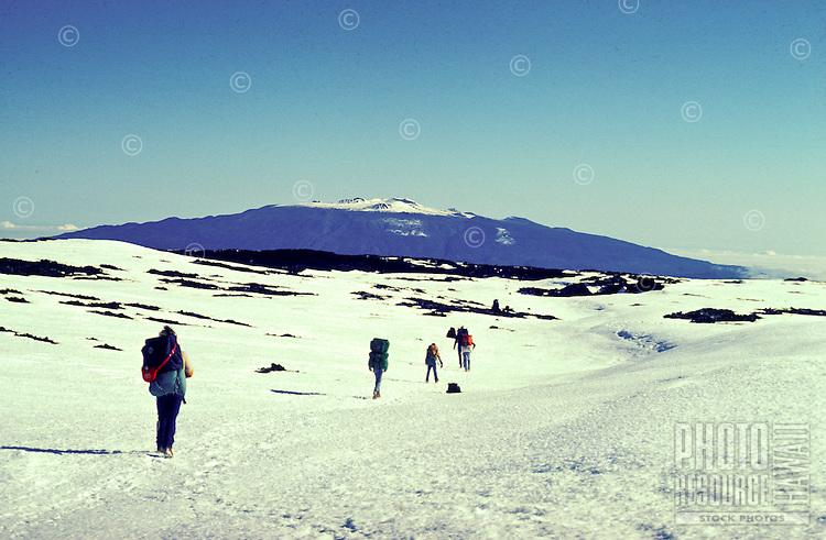Hiking on Mauna Loa with Mauna Kea in the distance, Big Island