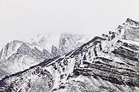 Fresh snow on the Brooks Range mountains reveal geological folds in the rock, Atigun Canyon, Arctic, Alaska
