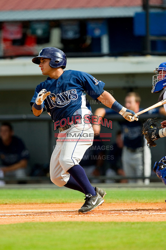 David Garcia (24) of the Princeton Rays follows through on his swing against the Burlington Royals at Burlington Athletic Park on July 5, 2013 in Burlington, North Carolina.  The Royals defeated the Rays 5-1 in game one of a doubleheader.  (Brian Westerholt/Four Seam Images)
