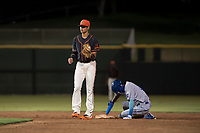 AZL Giants Black shortstop Abdiel Layer (17) looks to the umpire for the call after applying the tag to Maikel Garcia (4) on a stolen base attempt during an Arizona League game against the AZL Royals at Scottsdale Stadium on August 7, 2018 in Scottsdale, Arizona. The AZL Giants Black defeated the AZL Royals by a score of 2-1. (Zachary Lucy/Four Seam Images)