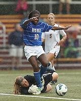 Boston College goalkeeper Alexandra Johnson (0) pushes ball away from attacking Duke University midfielder Toni Payne (10).Boston College (white) defeated Duke University (blue/white), 4-1, at Newton Campus Field, on October 6, 2013.