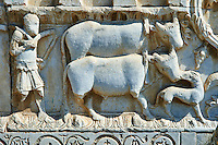 Sculpture of a man with two cows on the 12th century Romanesque facade of the Chiesa di San Pietro extra moenia (St Peters), Spoletto, Italy
