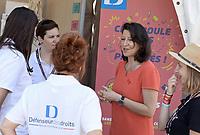 La ministre des solidarites et de la santé Agnes Buzyn visite avec Luc Barruet le site de Solidays à l'hippodrome de Longchamps