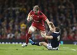 Wales lock Alun Wyn Jones hands off Scotland outside half Duncan Weir.<br /> RBS 6 Nations 2014<br /> Wales v Scotland<br /> Millennium Stadium<br /> <br /> 15.03.14<br /> <br /> ©Steve Pope-SPORTINGWALES