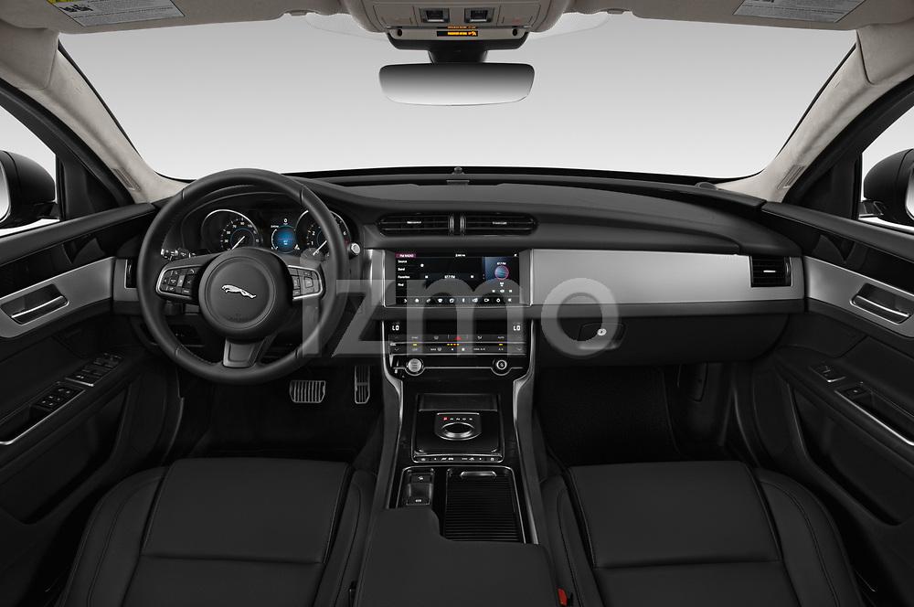 Stock photo of straight dashboard view of a 2020 Jaguar XF Premium 4 Door Sedan