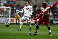 ATTENTION SPORTS PICTURE DESK<br /> Pictured: Leon Britton of Swansea (L) passing the ball while marked by Matthew Spring of Chrlton (R)<br /> Re: Coca Cola Championship, Swansea City FC v Charlton Athletic at the Liberty Stadium, Swansea, south Wales. 28 February 2009<br /> Picture by D Legakis Photography / Athena Picture Agency, Swansea 07815441513