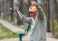 Joshua Williams of Centerton reacts after catching a crappie, Monday, April 5, 2021 at Lake Centerton in Centerton. Check out nwaonline.com/210406Daily/ for today's photo gallery. <br /> (NWA Democrat-Gazette/Charlie Kaijo)
