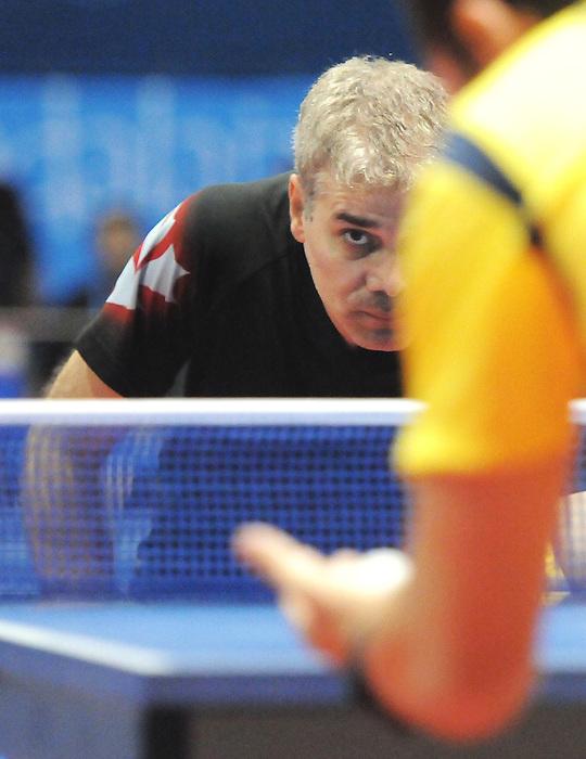 Masoud Mojtahed, Guadalajara 2011 - Para Table Tennis // Paratennis de table.<br /> Masoud Mojtahed of Canada taking on Paulo Salmin of Brazil in Men's Team C6-8 // Masoud Mojtahed du Canada affronte Paulo Salmin du Brésil dans l'équipe masculine C6-8. 11/18/2011.