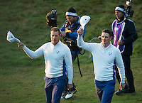 27.09.2014. Gleneagles, Auchterarder, Perthshire, Scotland.  The Ryder Cup, Day 2.  Justin Rose and Henrik Stenson (EUR) acknowledge the crowd as they walk on to the first tee for Saturday Fourballs.