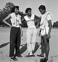 Tuskegee Women's Track and Field team members: Nell Jackson (L), Evelyn Lawler (center) and Ella McNabb (R), 1952, Tuskegee Alabama. Credit: © John G. Zimmerman Archive.
