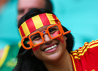 A Spain fan soaks up the atmosphere before kick off