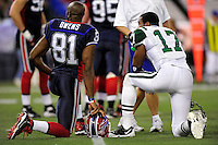 3 December 2009: Buffalo Bills' wide receiver Terrell Owens and New York Jets wide receiver Braylon Edwards have a break during a play review at the Rogers Centre in Toronto, Ontario, Canada. The Jets defeated the Bills 19-13. Mandatory Credit: Ed Wolfstein Photo