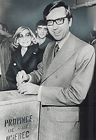 All eyes in Canada were on Quebec today to see if the separatist Parti Quebecois would unseat the ruling Liberal party in the provincial election. Party leaders Rene Levesque, right, of Parti Quebecois, and Liberal Premier Robert Bourassa, left, cast this morning in Montreal<br /> <br /> 1976<br /> <br /> PHOTO :  Doug Griffin - Toronto Star Archives - AQP