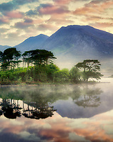 Sunrise on Derryclare Loch/lake with some of the 12 Ben Mountains. County Galway, Connemara, Ireland