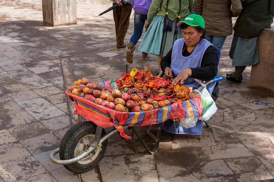 Peru, Cusco.  San Pedro Market.  Woman Selling Prickly Pear (Opuntia) Fruit.