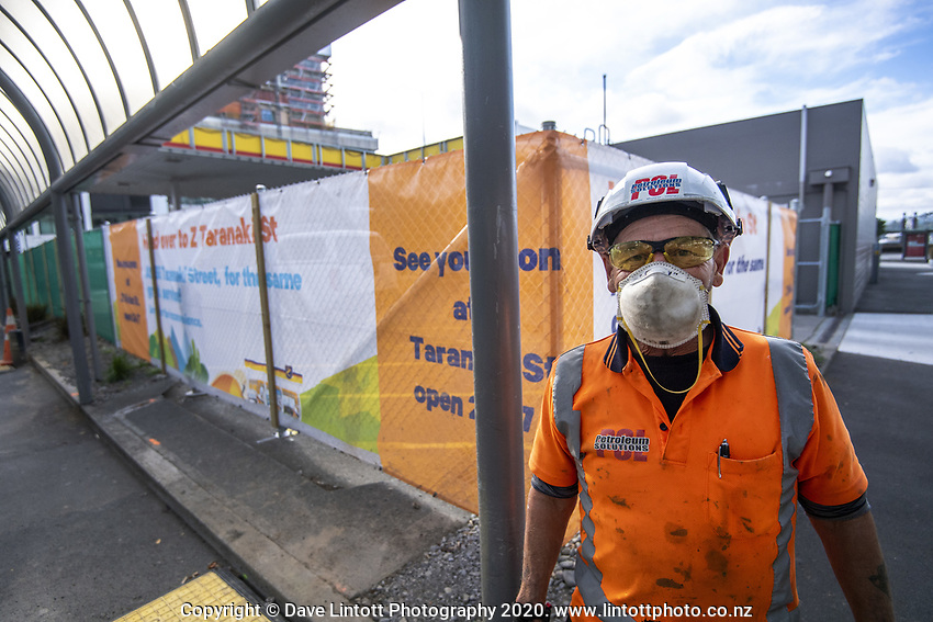 A face-masked contruction worker on Featherston Street at 9am, Friday during Level 3 lockdown for the COVID-19 pandemic in Wellington, New Zealand on Friday, 1 May 2020. Photo: Dave Lintott / lintottphoto.co.nz