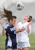 Springdale Har-Ber's Natalie Hathorn (4) collides Tuesday, April 27, 2021, with Rogers' Allison Golden (11) as the vie for the ball during the first half of play at Wildcat Stadium in Springdale. Visit nwaonline.com/210428Daily/ for today's photo gallery. <br /> (NWA Democrat-Gazette/Andy Shupe)