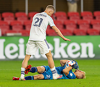 WASHINGTON, DC - MAY 13: Jon Kempin #21 of D.C. United winces after being fouled by Fabian Herbers #21 of Chicago Fire FC during a game between Chicago Fire FC and D.C. United at Audi FIeld on May 13, 2021 in Washington, DC.