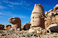 Pictures of the statues of around the tomb of Commagene King Antochus 1 on the top of Mount Nemrut, Turkey. Stock photos & Photo art prints. In 62 BC, King Antiochus I Theos of Commagene built on the mountain top a tomb-sanctuary flanked by huge statues (8–9 m/26–30 ft high) of himself, two lions, two eagles and various Greek, Armenian, and Iranian gods. The photos show the broken statues on the  2,134m (7,001ft)  mountain. 1