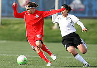 Rebecca Moros #19 of the Washington Freedom turns away from Karina Maruyama #11 of the Philadelphia Independence during a WPS pre season match at the Maryland Soccerplex on March 27 2010 in Boyds, Maryland. The game ended in a 0-0 tie.