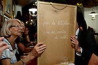 Reading the chalkboard menu in restaurant La Merenda, Nice, France, 16 October 2013