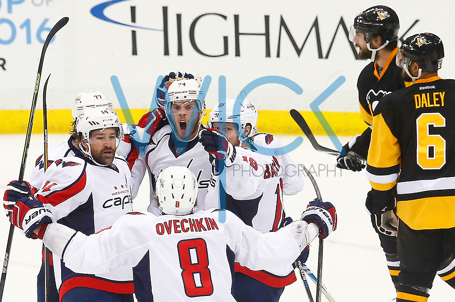 John Carlson #74 of the Washington Capitals reacts with his teammates after scoring the tying goal in the third period against the Pittsburgh Penguins during game six of the second round of the Stanley Cup Playoffs at Consol Energy Center in Pittsburgh, Pennsylvania on May 10, 2016. (Photo by Jared Wickerham / DKPS)