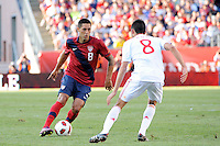 Clint Dempsey (8) of the United States is marked by Bruno Soriano (8) of Spain. The men's national team of Spain (ESP) defeated the United States (USA) 4-0 during a International friendly at Gillette Stadium in Foxborough, MA, on June 04, 2011.