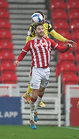 Huddersfield Town's Harry Toffolo jumps with Stoke City's Tom Edwards<br /> <br /> Photographer Mick Walker/CameraSport<br /> <br /> The EFL Sky Bet Championship - Stoke City v HUddersfield Town - Saturday 21st November 2020 - bet365 Stadium - Stoke<br /> <br /> World Copyright © 2020 CameraSport. All rights reserved. 43 Linden Ave. Countesthorpe. Leicester. England. LE8 5PG - Tel: +44 (0) 116 277 4147 - admin@camerasport.com - www.camerasport.com