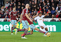 Pictured: Wayne Routledge of Swansea (R) is tackled by a West Ham player Saturday 10 January 2015<br /> Re: Barclays Premier League, Swansea City FC v West Ham United at the Liberty Stadium, south Wales, UK