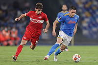 Zelimkhan Bakaev of FC Spartak Moskva and Piotr Zielinski of SSC Napoli compete for the ball during the Europa league 2021/2022 group C football match between SSC Napoli and FC Spartak Moskva at Diego Armando Maradona stadium in Napoli (Italy), September 30th, 2021. <br /> Photo Cesare Purini / Insidefoto