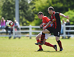 X of Newmarket Celtic A in action against Darren Murphy of Bridge United A during their Clare Cup Final at Frank Healy Park. Photograph by John Kelly.