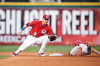 Buffalo Bisons second baseman Andy Burns (8) swipes the tag as Juan Perez (4) slides into second during a game against the Louisville Bats on June 20, 2016 at Coca-Cola Field in Buffalo, New York.  Louisville defeated Buffalo 4-1.  (Mike Janes/Four Seam Images)