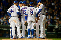 Chicago Cubs pitching coach Chris Bosio talks with pitcher Carl Edwards Jr., (6) as Wilson Contreras (40), Anthony Rizzo (44), Javier Baez (9), Kris Bryant (17), and Addison Russell (27) listen in in the seventh inning during Game 5 of the Major League Baseball World Series against the Cleveland Indians on October 30, 2016 at Wrigley Field in Chicago, Illinois.  (Mike Janes/Four Seam Images)