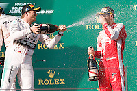 March 15, 2015: Nico Rosberg (DEU) #6 (2nd) and Sebastian Vettel (DEU) #5 (3rd) spray champagne on the podium at the 2015 Australian Formula One Grand Prix at Albert Park, Melbourne, Australia. Photo Sydney Low