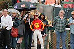 Jockey Mike Smith and co-trainer Jimmy Barnes watching the tote board under umbrella after the running of the Rebel Stakes (Grade II) at Oaklawn Park in Hot Springs, Arkansas-USA on March 15, 2014. (Credit Image: © Justin Manning/Eclipse/ZUMAPRESS.com)